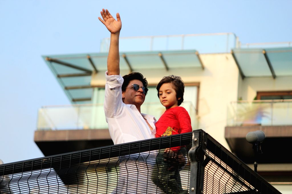 Actor Shahrukh Khan and his son AbRam Khan. (Photo: IANS) - Shahrukh Khan