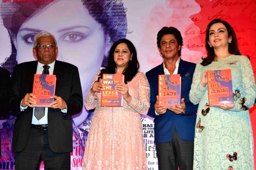 Actor Shahrukh Khan and Nita Ambani, Founder and Chairperson, Reliance Foundation during the launch of author Gunjan Jain book She Walks She Leads, in Mumbai, on July 21, 2016. The Book ... - Shahrukh Khan, Nita Ambani, Gunjan Jain, Priyanka Chopra and Kareena Kapoor Khan