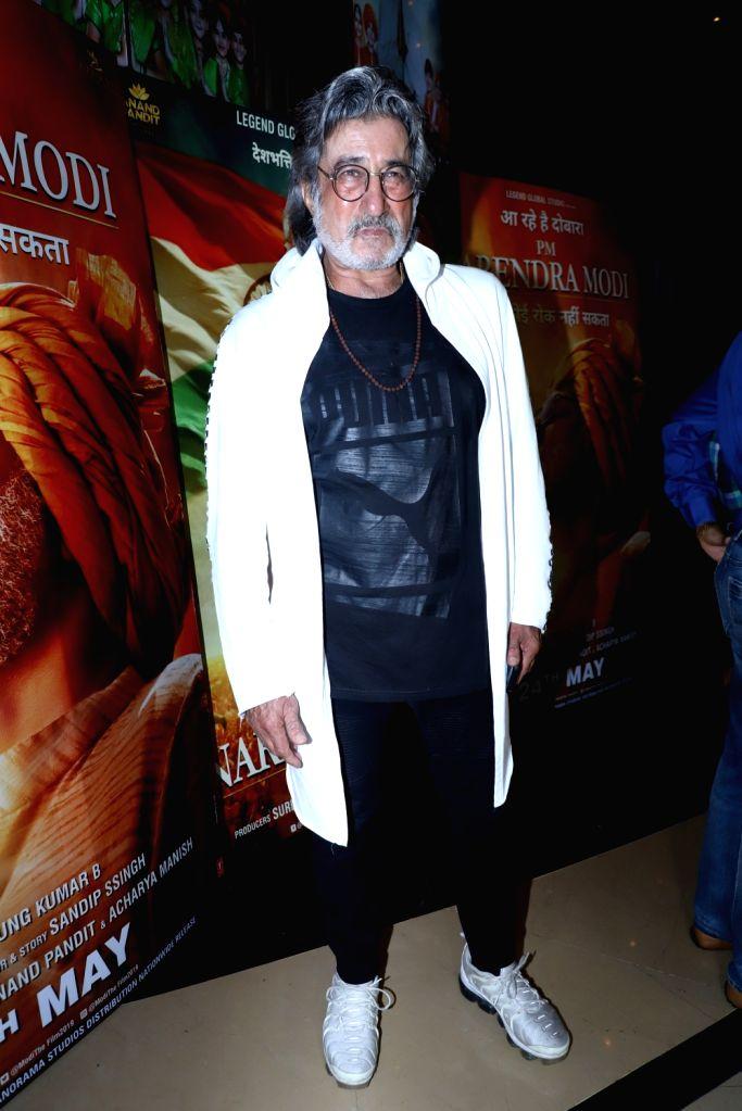 "Actor Shakti Kapoor at the screening of the upcoming film ""PM Narendra Modi"" in Mumbai on May 23, 2019. - Shakti Kapoor and Narendra Modi"