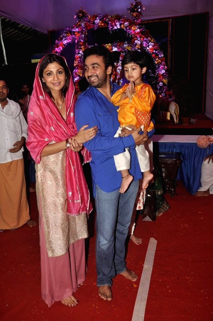 Actor Shilpa Shetty along with her husband Raj Kundra and son Viaan at ISKCON temple to seek the blessing of Lord Krishna on the occasion of Janamashtmi, in Mumbai, on Aug. 17, 2014. - Raj Kundra