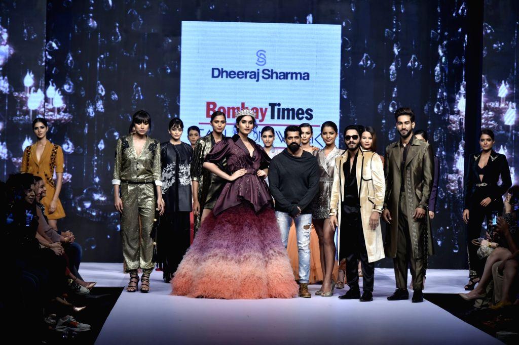Actor Shreyas Talpade, model Nehal Chudasama with fashion designer Dheeraj Sharma at Bombay Times Fashion Week Spring/ Summer 2019 in Mumbai, on March 25, 2019. - Shreyas Talpade and Dheeraj Sharma