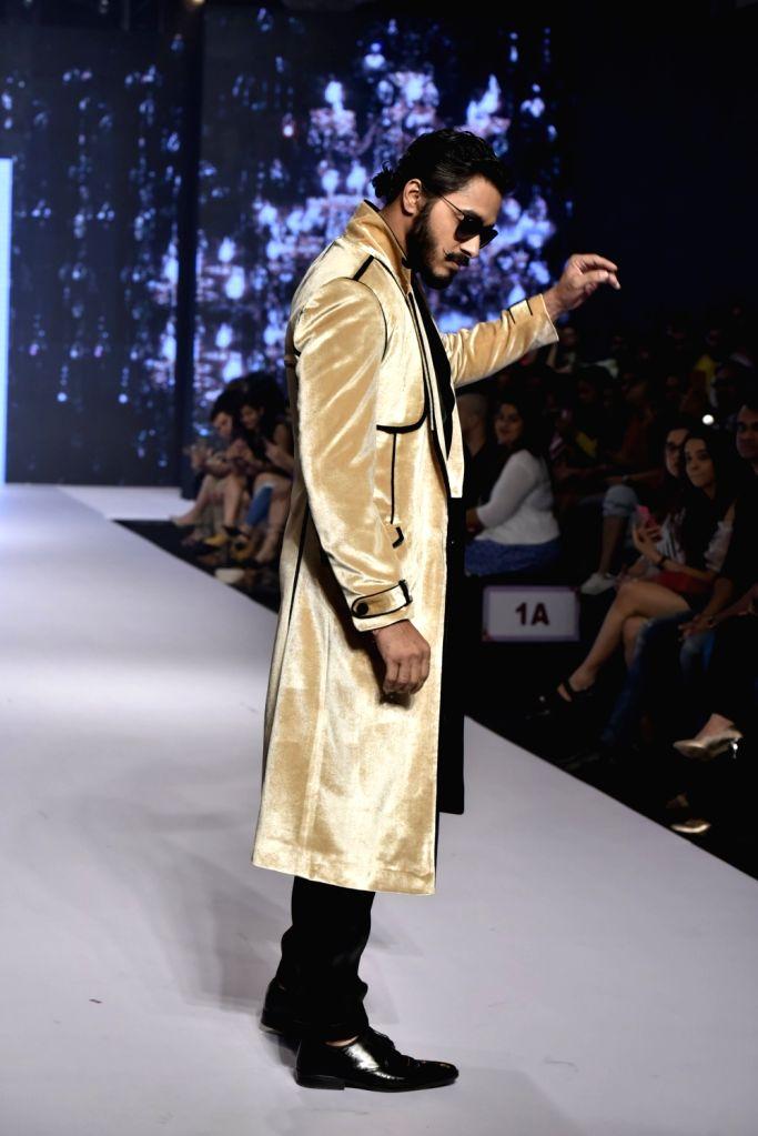 Actor Shreyas Talpade showcases a creation of fashion designer Dheeraj Sharma at Bombay Times Fashion Week Spring/ Summer 2019 in Mumbai, on March 25, 2019. - Shreyas Talpade and Dheeraj Sharma