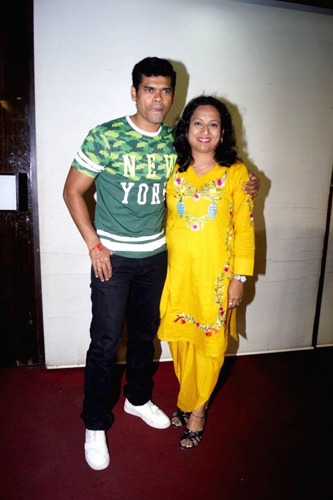 Actor Siddharth Jadhav along with his wife Trupti during the celebration of Actor Mubeen Saudagar Wife's Baby Shower ceremony in Mumbai on Sept 18, 2017. - Siddharth Jadhav