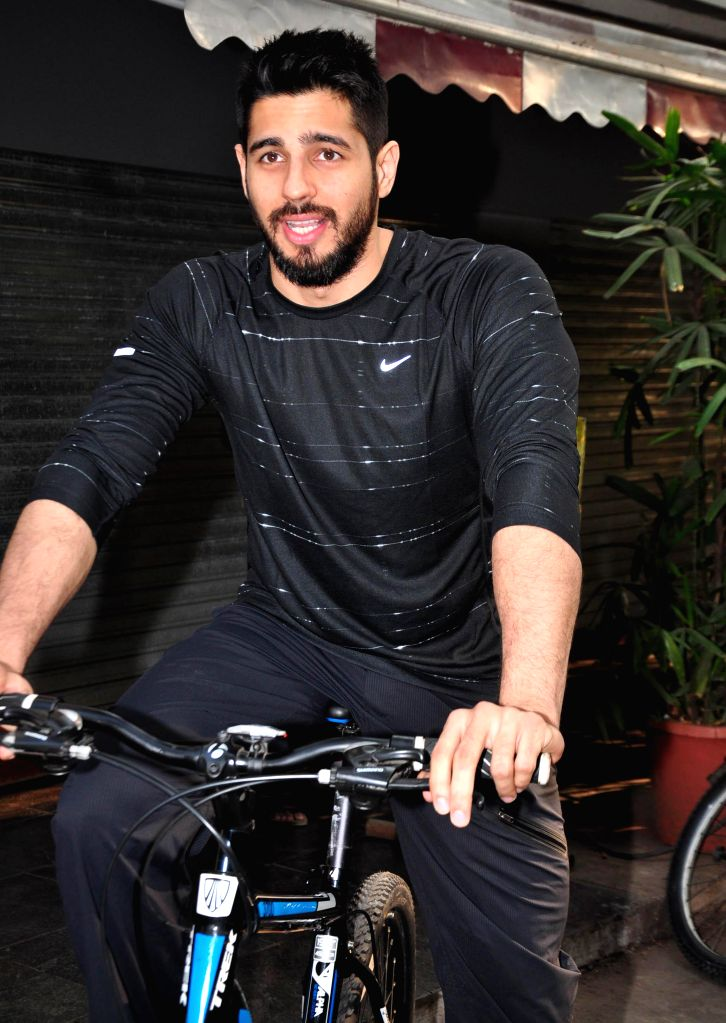 Actor Sidharth Malhotra cycles at The Equal Street Movement in Bandra, Mumbai on Nov. 24, 2014.