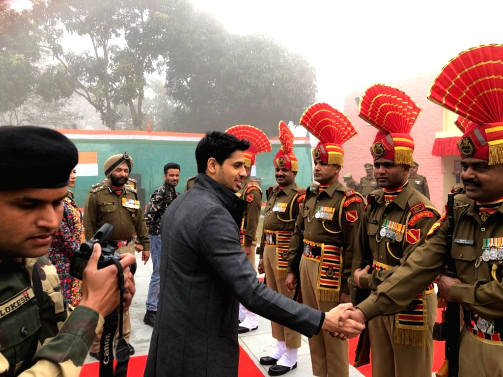 Actor Sidharth Malhotra shakes hands with soldiers on Republic Day at BSF Khasa camp near  Amritsar  in Punjab, on Jan 26, 2018. - Sidharth Malhotra