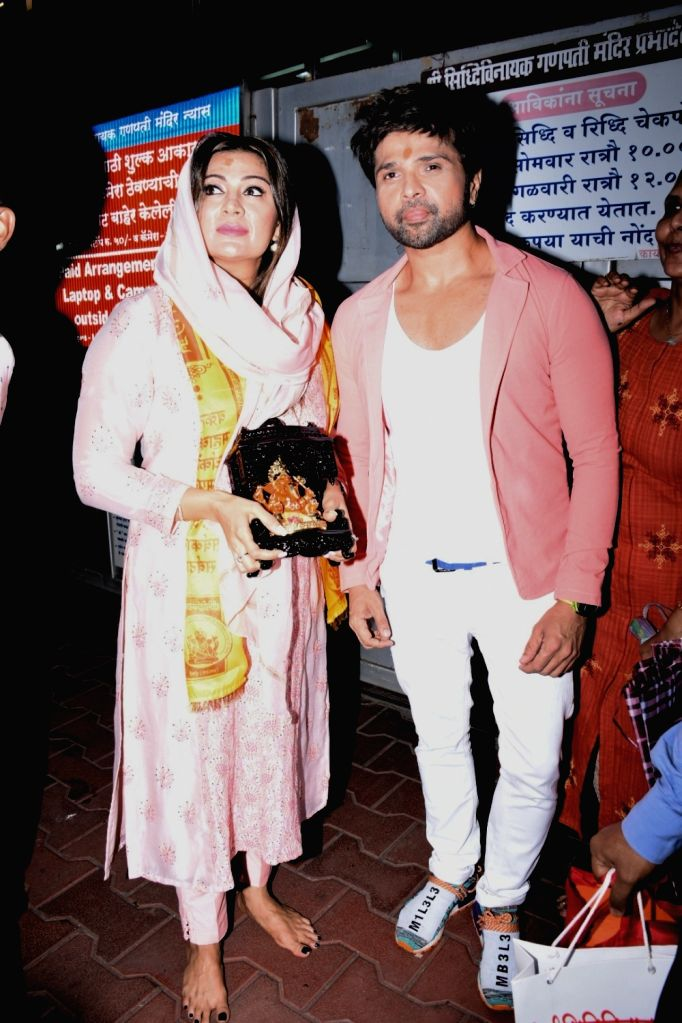 Actor-singer Himesh Reshammiya with his wife Sonia Kapoor during their visit at Siddhivinayak Temple in Mumbai, on July 23, 2019. - Sonia Kapoor