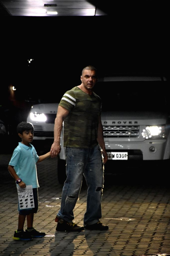 Actor Sohail Khan and his son Yohan Khan seen outside his house, in Mumbai, on June 16, 2019. - Sohail Khan and Yohan Khan