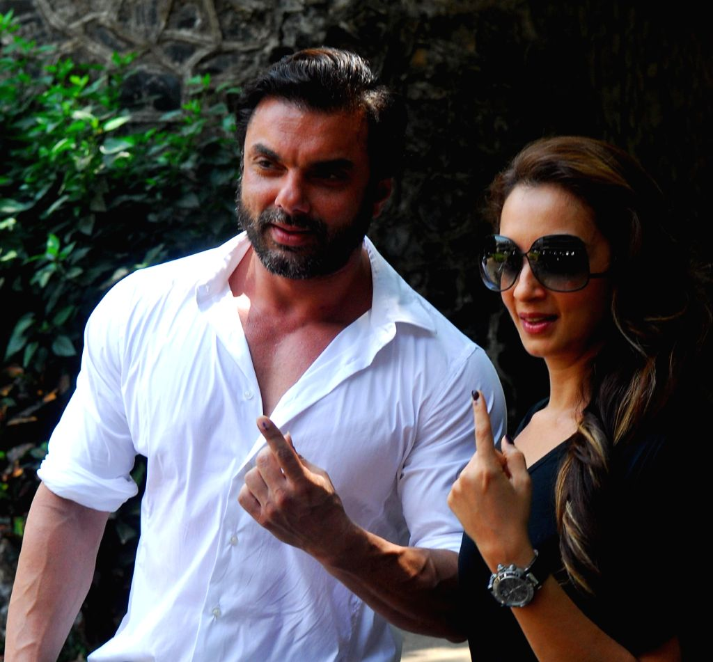 Actor Sohail Khan shows his fore finger marked with phosphorous ink after casting his vote at a polling booth during the sixth phase of 2014 Lok Sabha Polls in Mumbai on April 24, 2014.