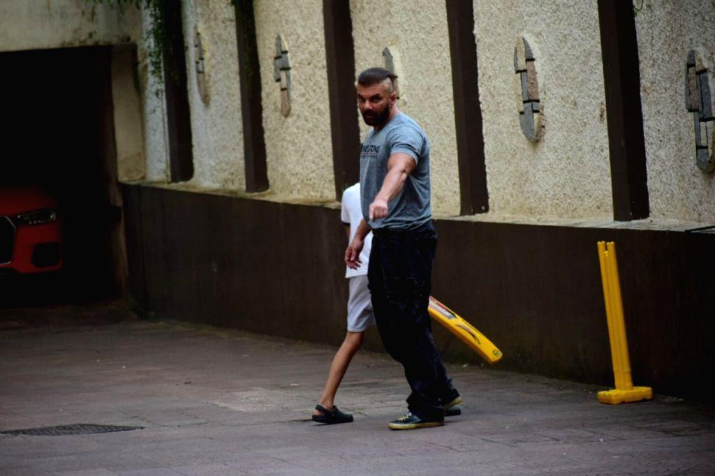 Actor Sohil Khan and son playing cricket at home in Mumbai on October 25, 2020. - Sohil Khan