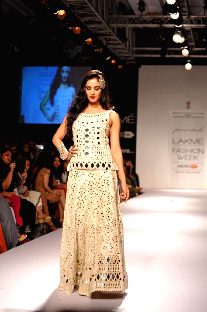 Actor Sonal Chauhan displays the creation of fashion designer Purvi Doshi during the Lakme Fashion Week (LFW) Winter/ Festive 2014 in Mumbai, on Aug. 21, 2014. - Sonal Chauhan
