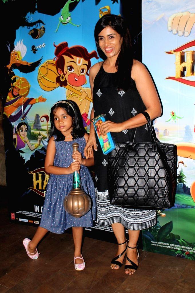 Actor Sonali Kulkarni with her daughter during the screening of film Hanuman Da Damdaar in Mumbai on June 1, 2017. - Sonali Kulkarni