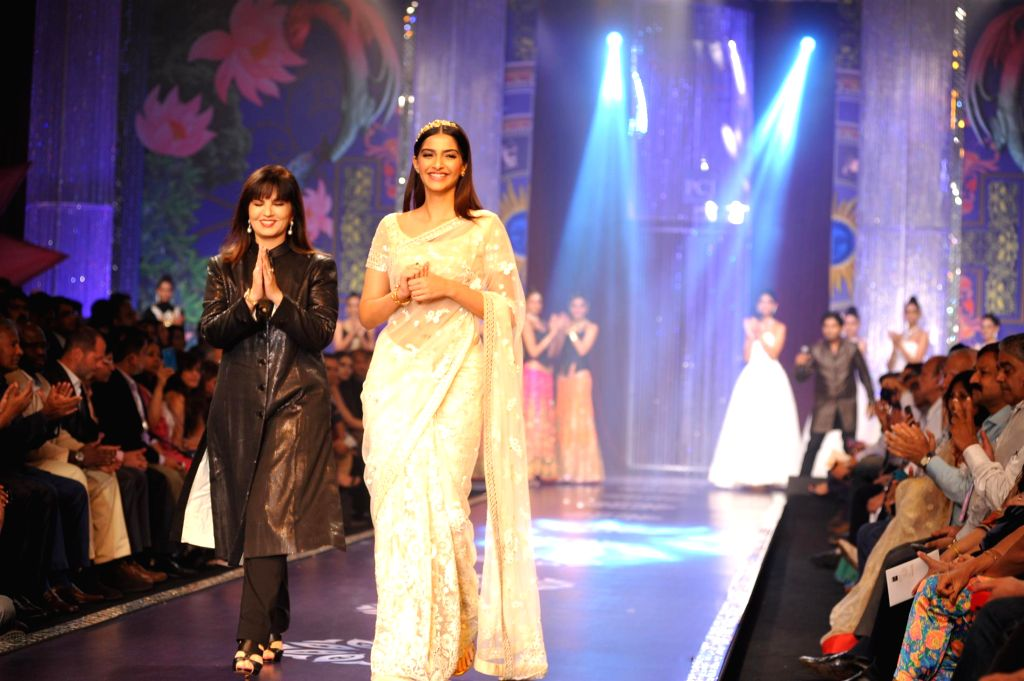 Actor Sonam Kapoor with fashion designer Neeta Lulla during the grand finale of India International Jewellery Week (IIJW) in Mumbai on July 17, 2014.
