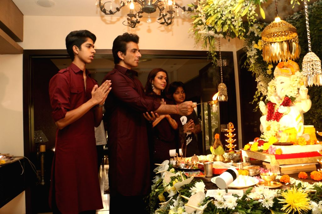 Actor Sonu Sood and his wife Sonali Sood offer prayers to Lord Ganesha during Ganesh Chaturthi celebrations, in Mumbai on Sep 2, 2019. - Sonu Sood