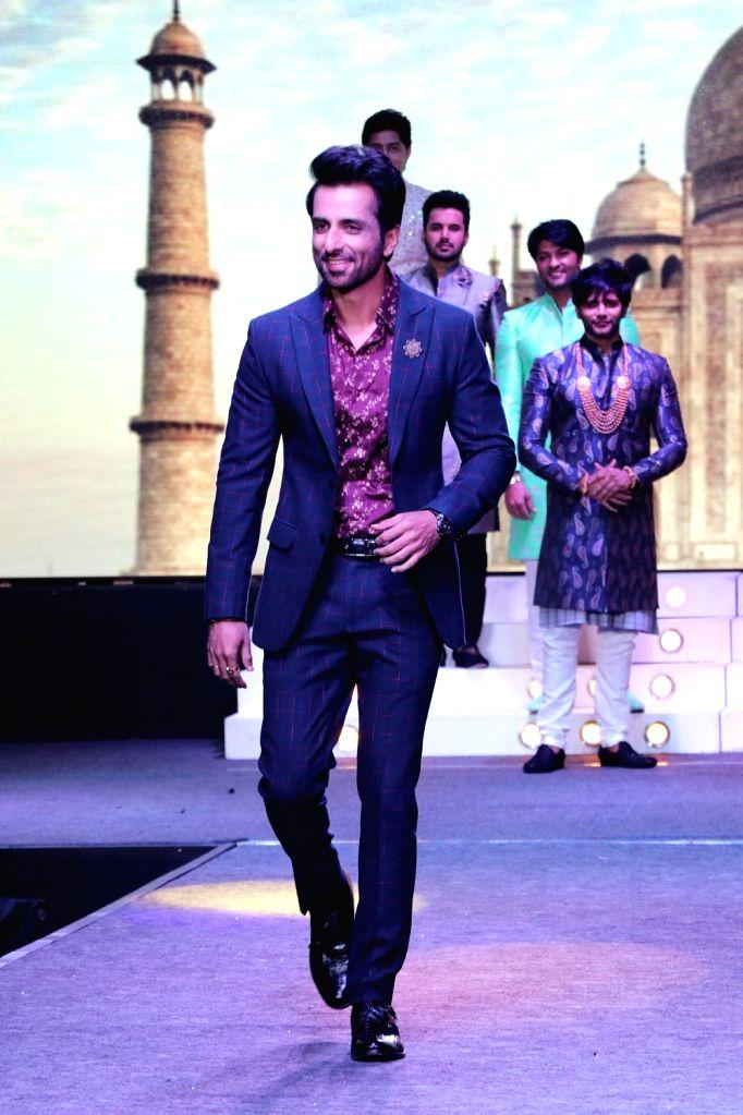 Actor Sonu Sood walks the ramp during the launch of a design studio, in Bengaluru on May 26, 2018. - Sonu Sood