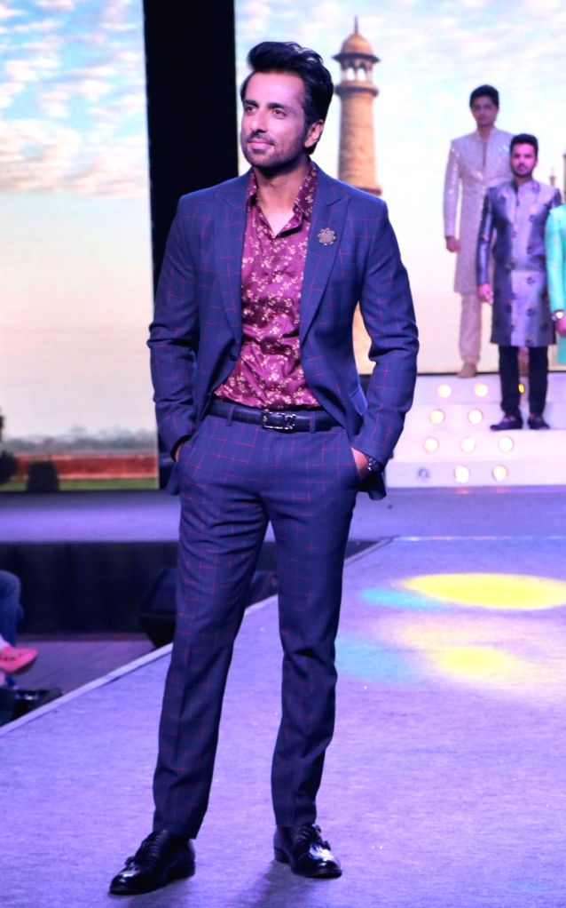 Actor Sonu Sood walks the ramp during the launch of a design studio, in Bengaluru on May 26, 2018. - Sonu Sood