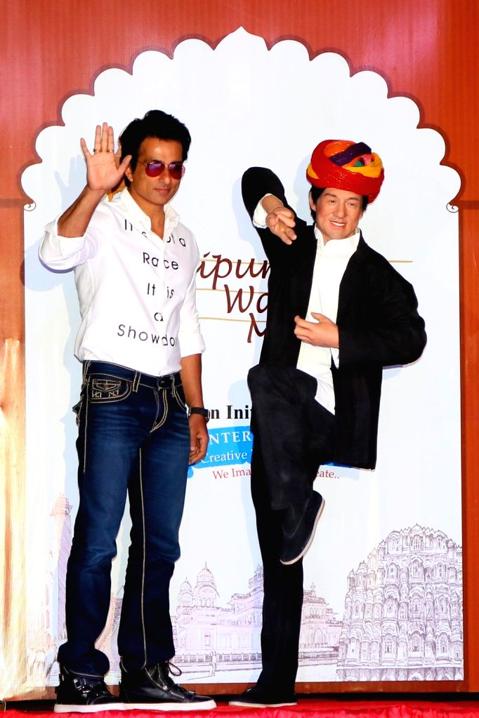 Actor Sonu Sood with the wax statue of Jackie Chan in Jaipur, on April 5, 2016. - Sonu Sood