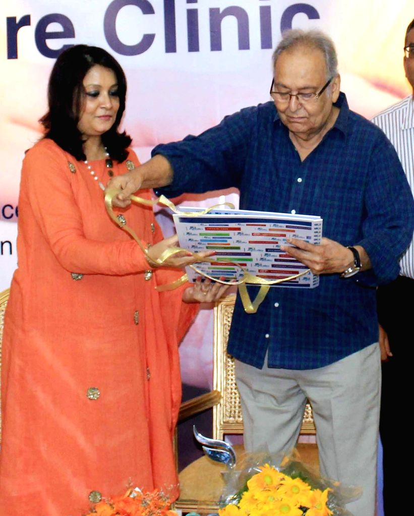 Actor Soumitra Chatterjee and Apollo Hospitals CEO (Eastern Region) Dr. Rupali Basu during a promotional programme in Kolkata, on June 17, 2016. - Soumitra Chatterjee and Rupali Basu
