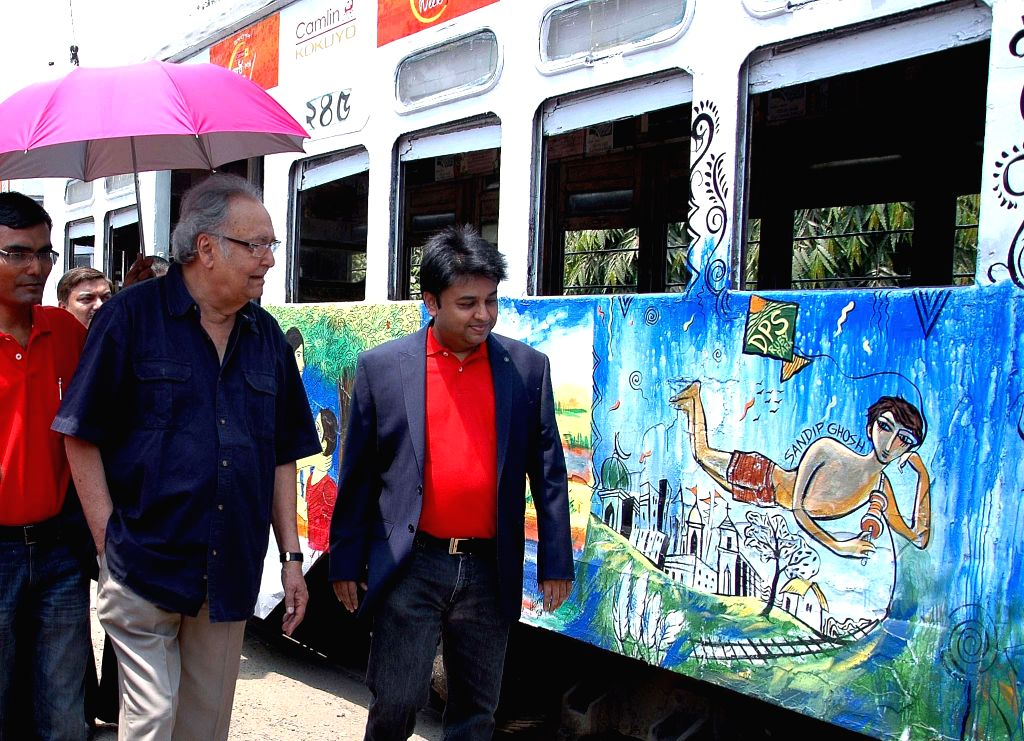 Actor Soumitra Chatterjee visiting an art exhibition on tram cars in Kolkata on April 19, 2014. - Soumitra Chatterjee