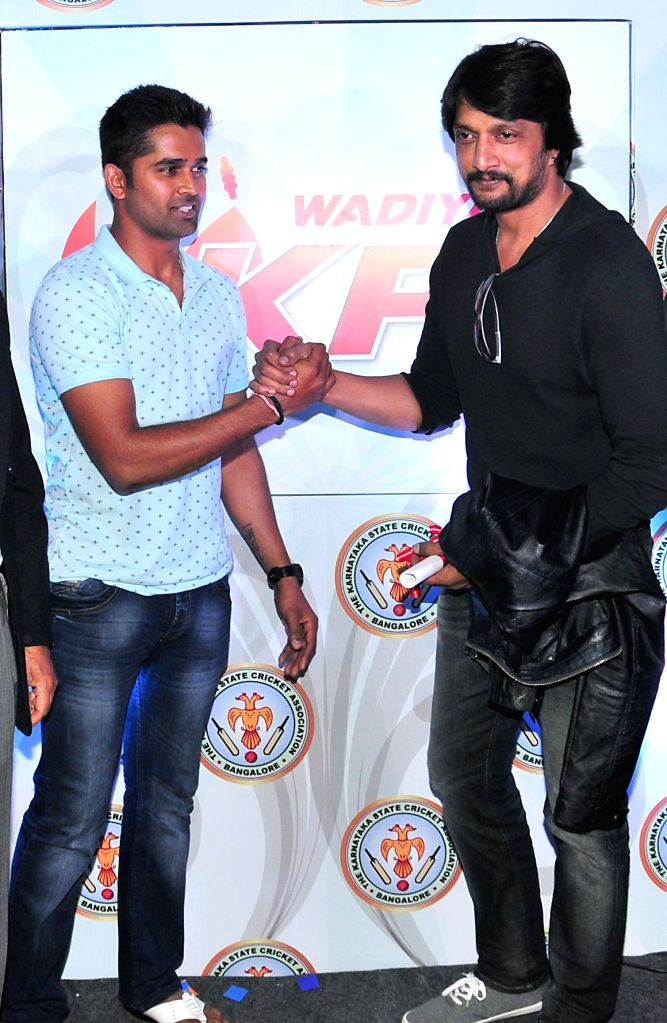 Actor Sudeep with cricketer Vinay Kumar during press conference regarding KPL (Karnataka Premier League) at Chinnaswamy Stadium in Bangalore on July 30, 2014. - Sudeep and Vinay Kumar