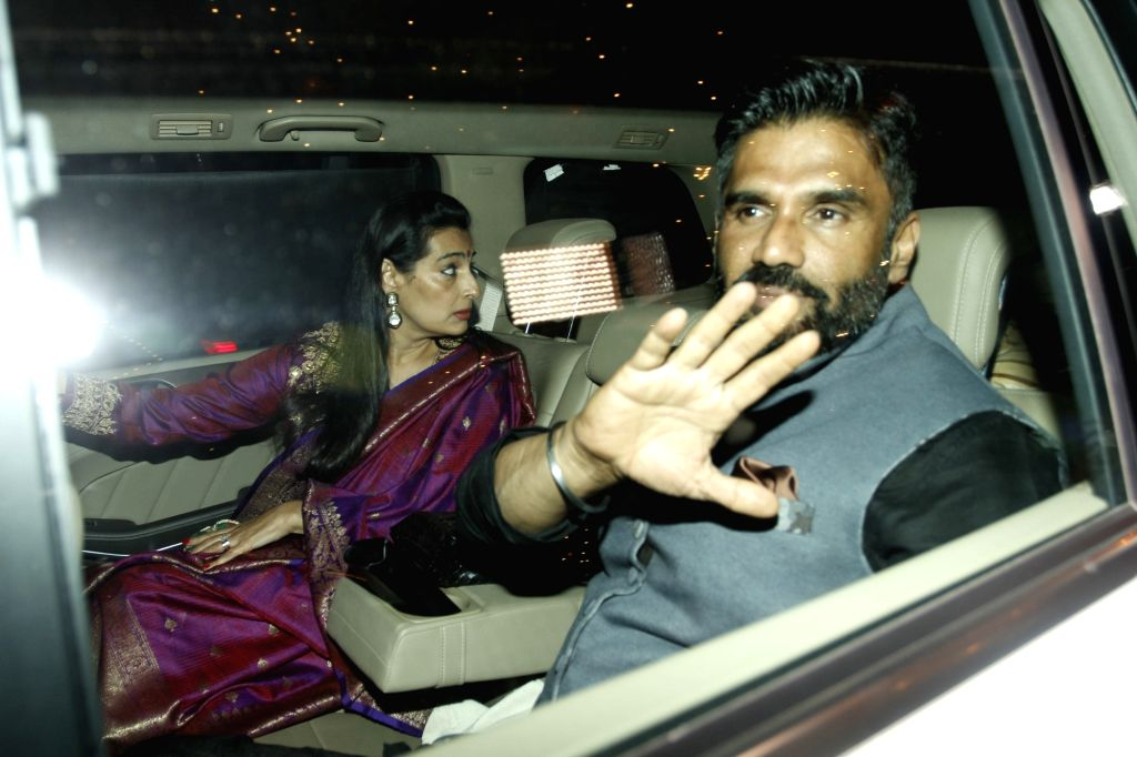 Actor Suneil Shetty with wife Mana Shetty arrive to attend the Amitabh Bachchan's Diwali party in Mumbai on Nov 11, 2015. - Suneil Shetty and Mana Shetty