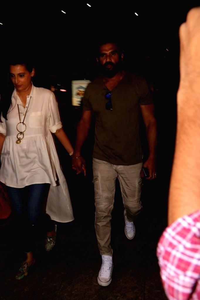 Actor Suniel Shetty along with his wife Mana Shetty spotted at Chhatrapati Shivaji Maharaj International Airport in Mumbai, on June 10, 2017. - Suniel Shetty and Mana Shetty