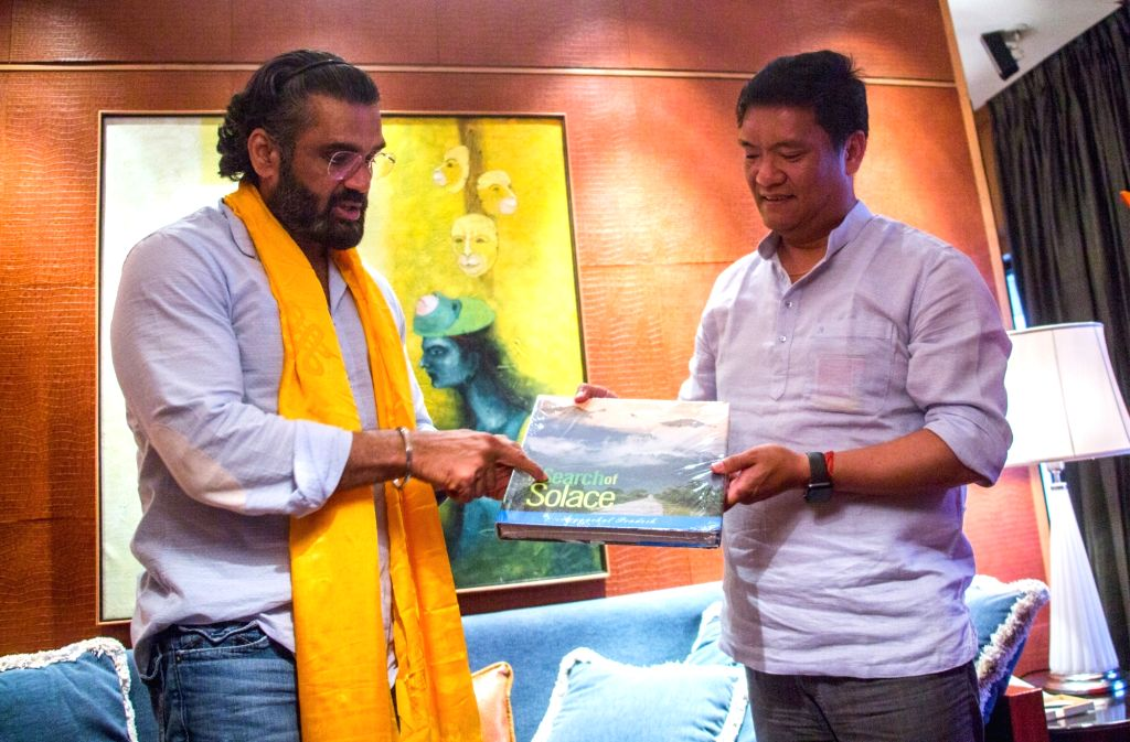 Actor Suniel Shetty meets Arunachal Pradesh Chief Minister Pema Khandu, in Mumbai on June 13, 2019. During the meeting, Chief Minister had discussion with the actor on how to promote ... - Suniel Shetty