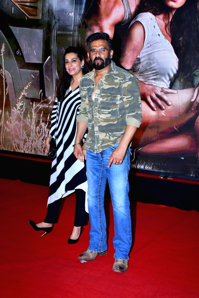 "Actor Suniel Shetty with wife during the special screening of film ""Baaghi 2"" on March 29, 2018. - Suniel Shetty"