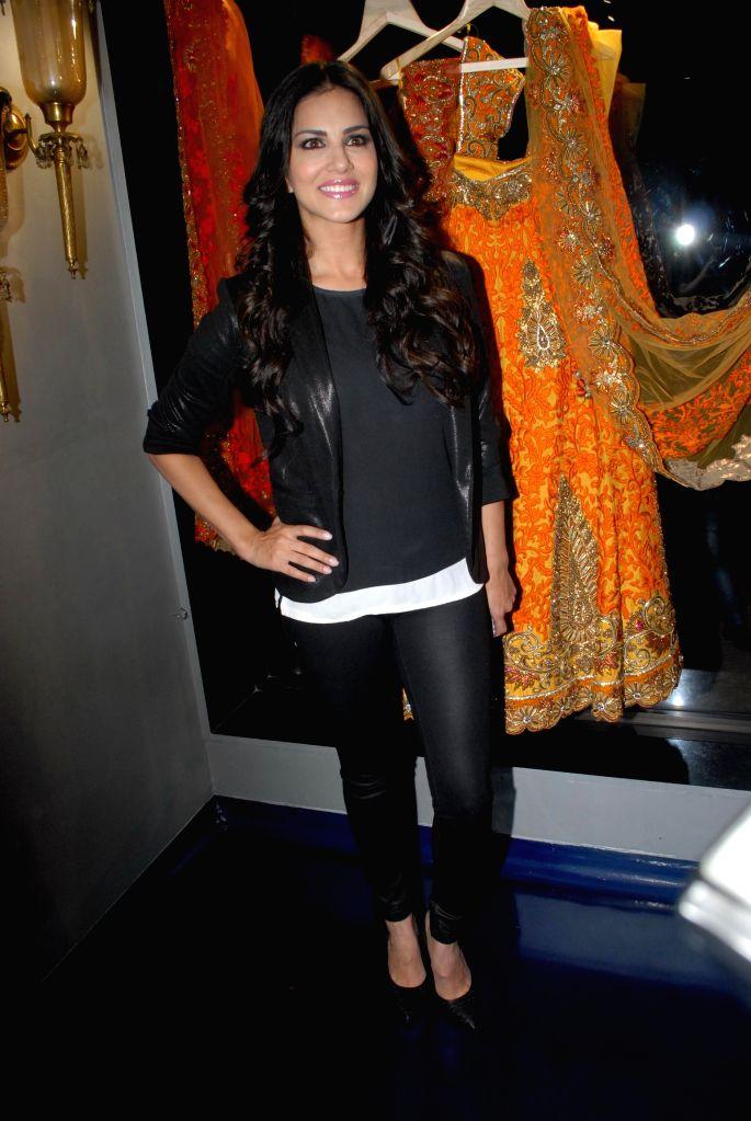 Actor Sunny Leone during the store opening of designer Mayyur Girotra in Mumbai, on April 18, 2014. - Sunny Leone