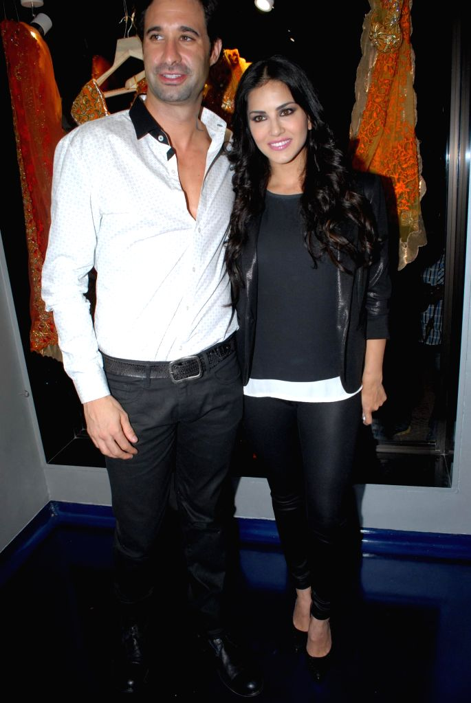Actor Sunny Leone with her husband Daniel Weber during the store opening of designer Mayyur Girotra in Mumbai, on April 18, 2014. - Sunny Leone