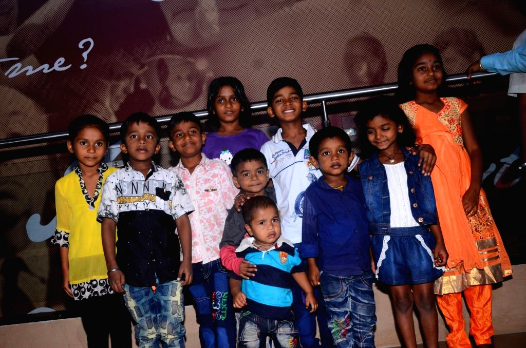 """Actor Sunny Pawar with his brodher Jignesh Pawar, sister Divisha Pawar and friends during the special screening of film """"Lion"""" in Mumbai on March 11, 2017. - Sunny Pawar"""