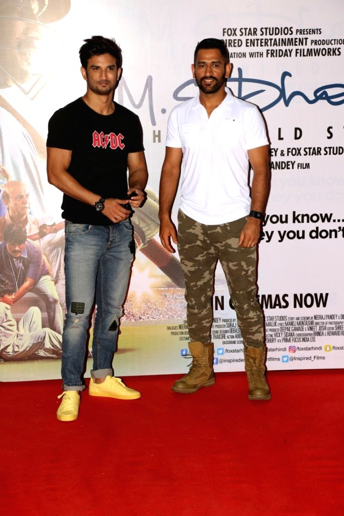 Actor Sushant Singh Rajput and cricket player Mahendra Singh Dhoni during the promotion of film M S Dhoni in Mumbai on Sept. 30, 2016. - Sushant Singh Rajput and Mahendra Singh Dhoni