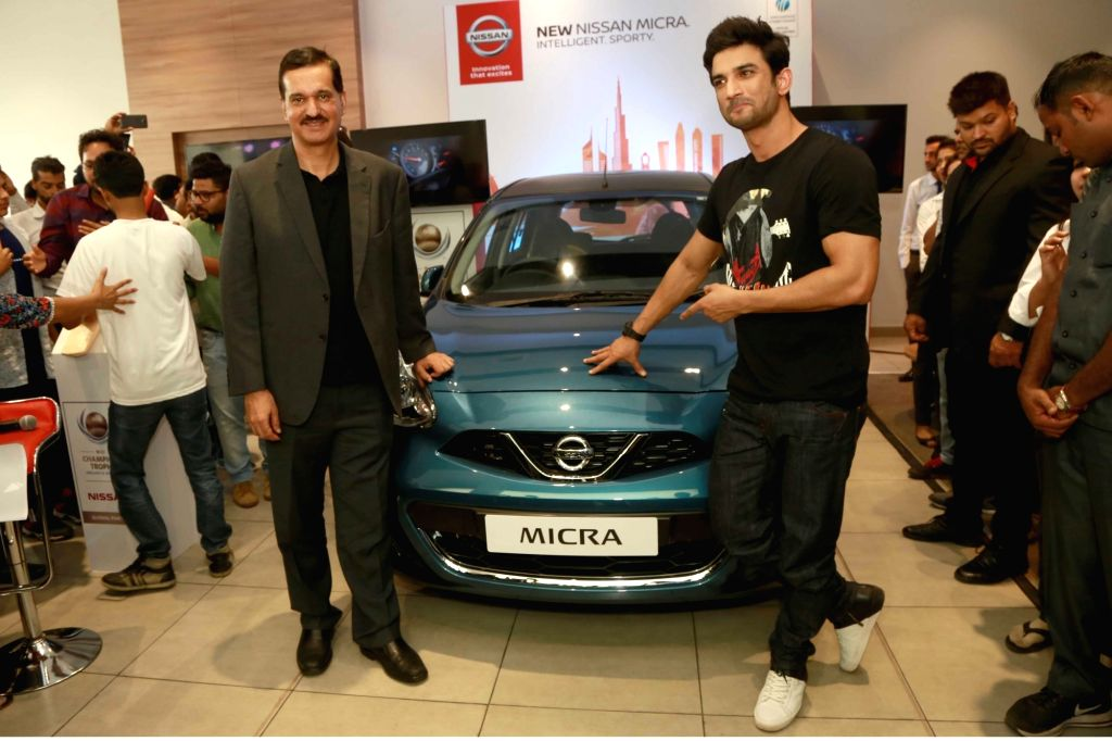 Actor Sushant Singh Rajput and Nissan Motor India MD Arun Malhotra during a special event organised to wish Indian cricket team for the ICC champion's trophy in Noida, Uttar Pradesh on June ... - Sushant Singh Rajput and Arun Malhotra
