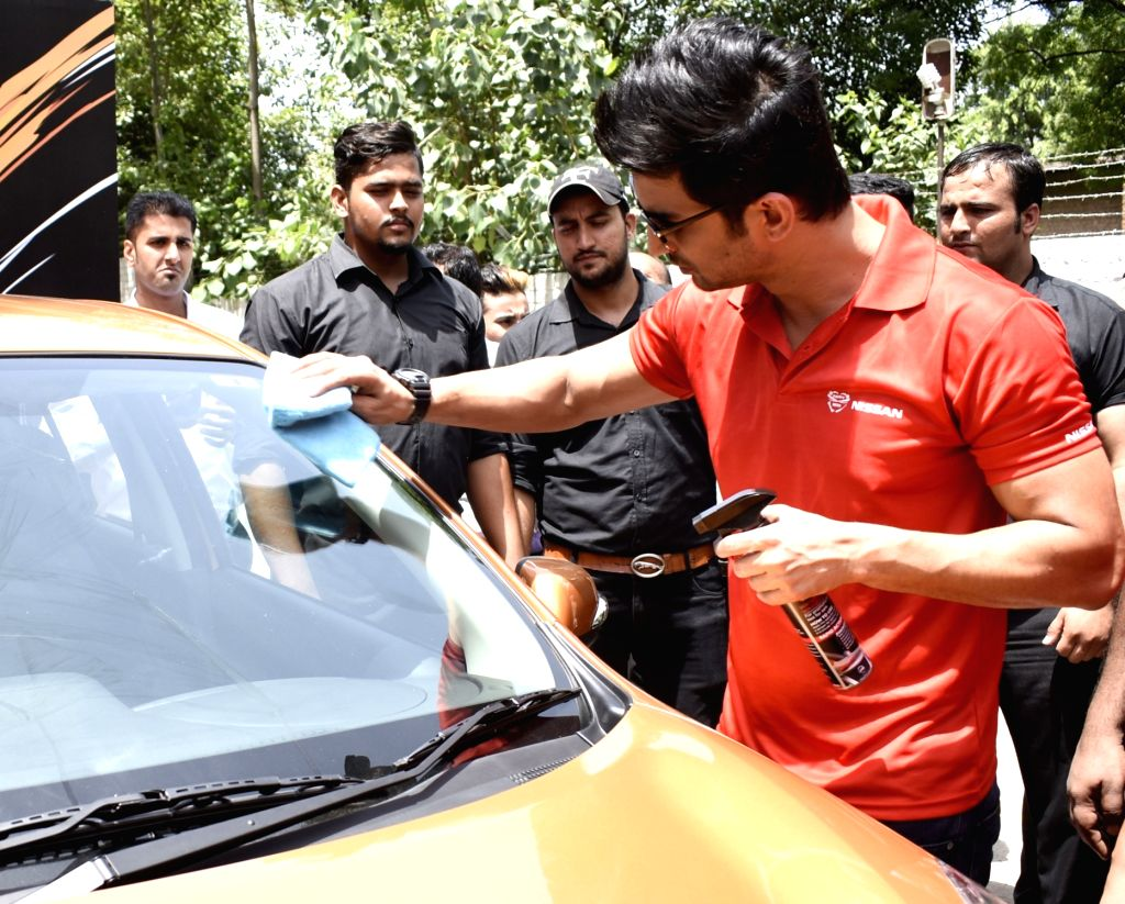 Actor Sushant Singh Rajput during the launch of Waterless Car Cleaning initiative at Nissan workshop in Gurugram on Aug 17, 2017. - Sushant Singh Rajput