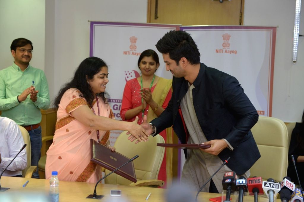 Actor Sushant Singh Rajput signs an initiative to promote the Women Entreprenuership Platform (WEP) of NITI Aayog in New Delhi on May 25, 2018. - Sushant Singh Rajput
