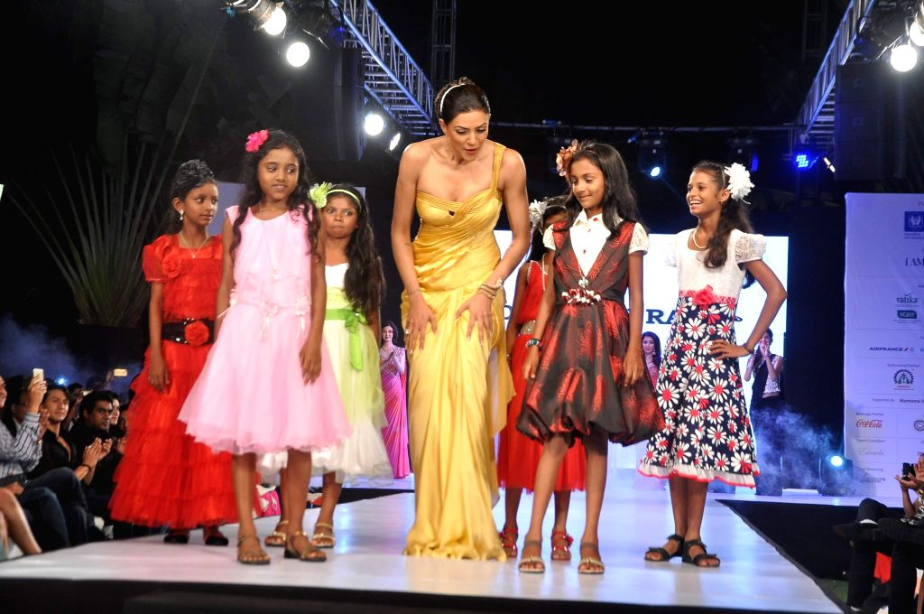 Actor Sushmita Sen walks on the ramp during the 5th edition of charity fashion show, Ramp for Champs organised by Smile Foundation, in Mumbai, on April 19, 2014. - Sushmita Sen