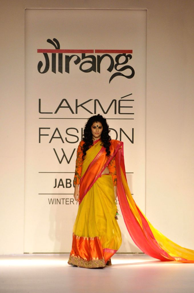 Actor Taapsee Pannu walks on the ramp for designer Gaurang Shah during the Lakme Fashion Week (LFW) Winter/ Festive 2014, in Mumbai, on Aug. 22, 2014. - Taapsee Pannu