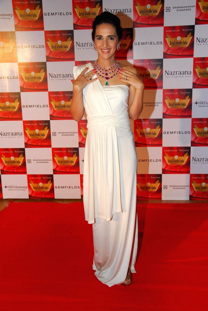 Actor Tara Sharma during the 10th Annual Gemfields and Nazraana Retail Jeweller India Awards 2014 in Mumbai on July 19, 2014. (Photo : IANS) - Tara Sharma