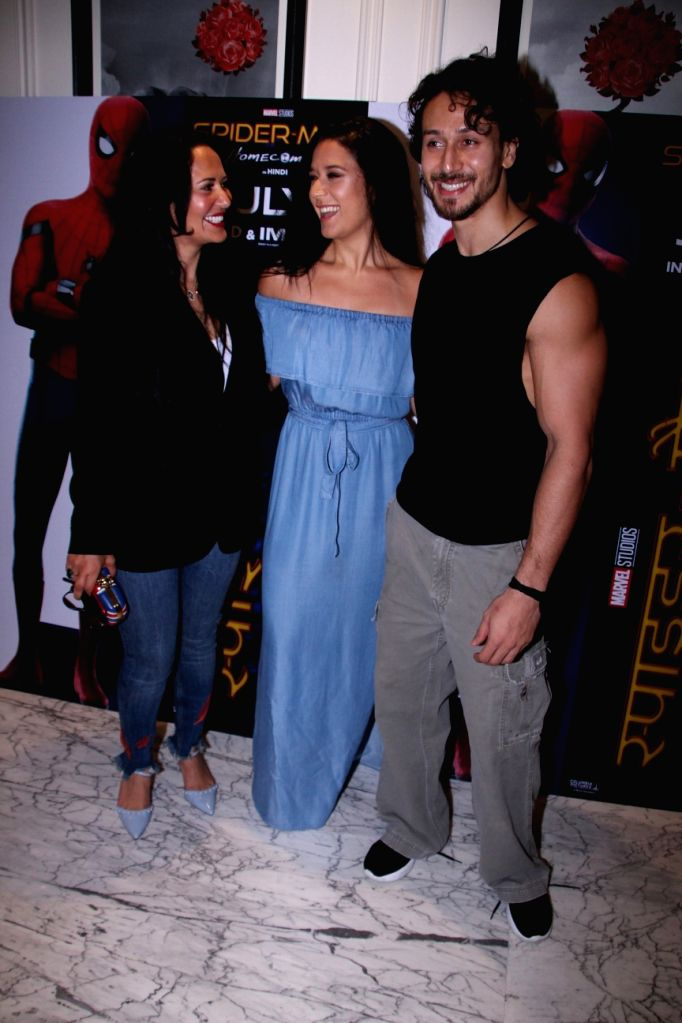 """Actor Tiger Shroff along with his sister Krishna Shroff and mother Ayesha Shroff during a promotional programme of the film """"Spider-Man: Homecoming"""" in Mumbai, on July 7, 2017. - Tiger Shroff"""