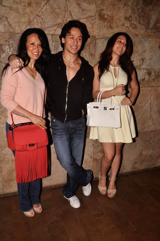 Actor Tiger Shroff along with his with his mother Ayesha Shroff and sister Krishna Shroff during the launch of his dance video as a tribute to pop icon Michael Jackson on the occasion of Teacher`s ...