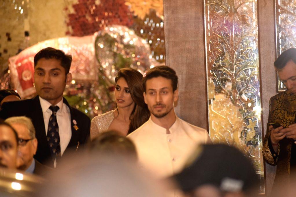 Actor Tiger Shroff at the wedding ceremony of industrialist Mukesh Ambani's daughter Isha Ambani and Anand Piramal at Antilia in Mumbai on Dec 12, 2018. - Tiger Shroff, Mukesh Ambani and Isha Ambani