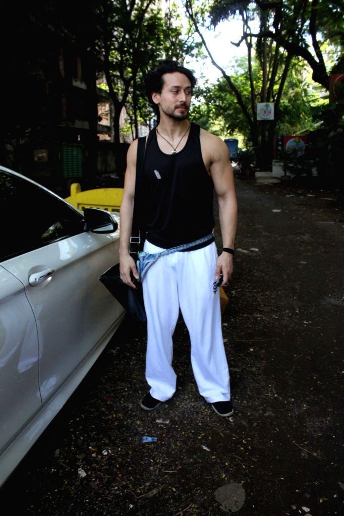 Actor Tiger Shroff seen at a dubbing studio in Mumbai's Juhu on June 24, 2020. - Tiger Shroff
