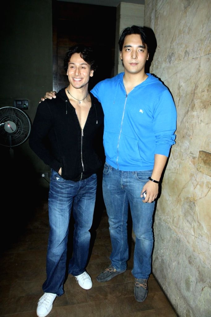 Actor Tiger Shroff with actor Danny Denzongpa`s son Rinzing Denzongpa during the launch of his dance video as a tribute to pop icon Michael Jackson on the occasion of Teacher`s Day in Mumbai, on ...