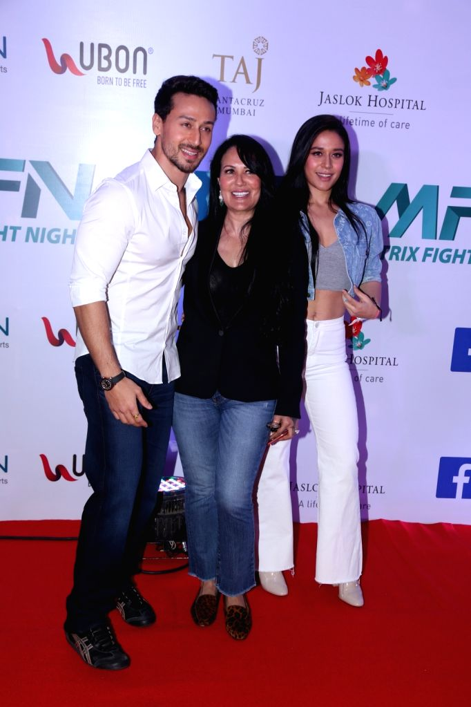 Actor Tiger Shroff with his mother Ayesha Shroff and his sister Krishna Shroff at Matrix Fight Night Red Carpet in Mumbai, on March 12, 2019. - Tiger Shroff