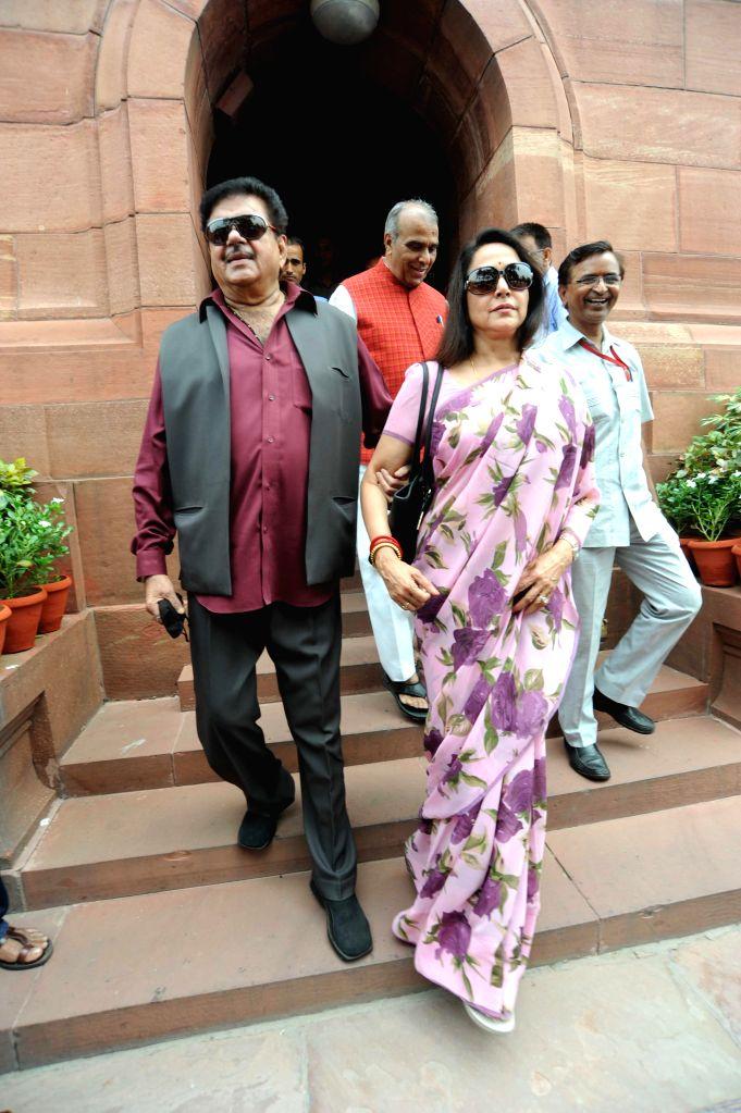 Actor turned politician and BJP MP from Patna Sahib Shatrughan Sinha and BJP MP from Mathura, actress  Hema Malini at the Parliament on Aug 5, 2014. - Hema Malini