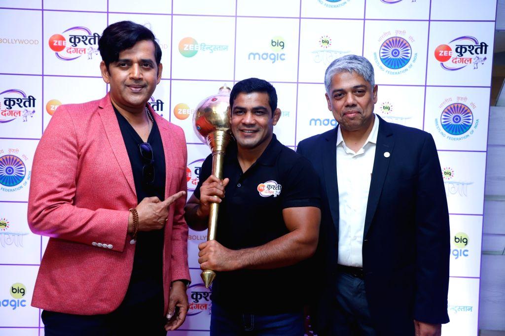 Actor-turned-politician Ravi Kishan, wrestler Sushil Kumar and International Business & ZEEL ??? Head of Sports Business COO Mukund Cairae during the launch of Kushti Dangal in New ... - Sushil Kumar