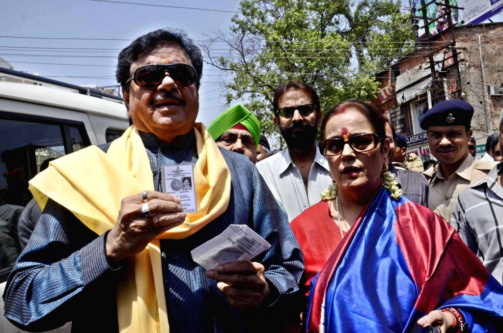 Actor turned politician Shatrughan Sinha shows his voter's identity card after casting his vote during the fifth phase of 2014 Lok Sabha Polls in Patna on April 17, 2014.