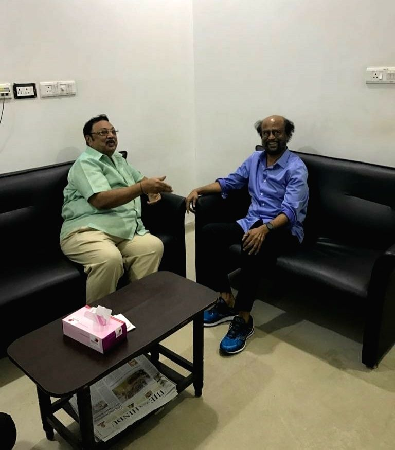 Actor-turned politicians Rajinikanth with DMK Chief M Karunanidhi's son MK Alagiri during his visit to the Kauvery Hospital where DMK President M. Karunanidhi is admitted, in Chennai on July ...