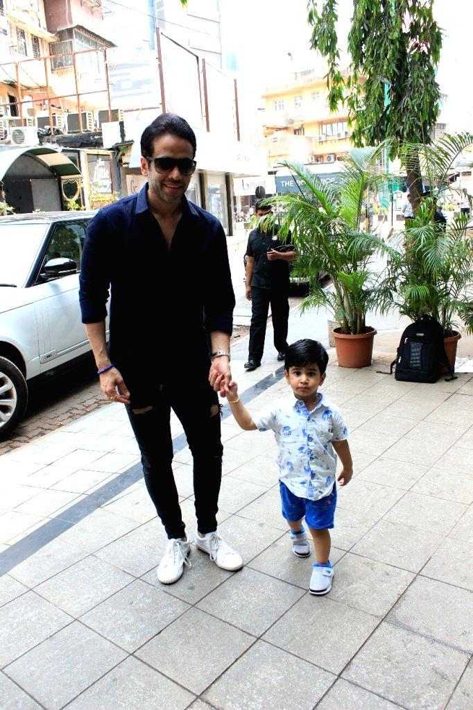 Actor Tusshar Kapoor and son Lakshya seen at Bandra in Mumbai on April 7, 2018. - Tusshar Kapoor