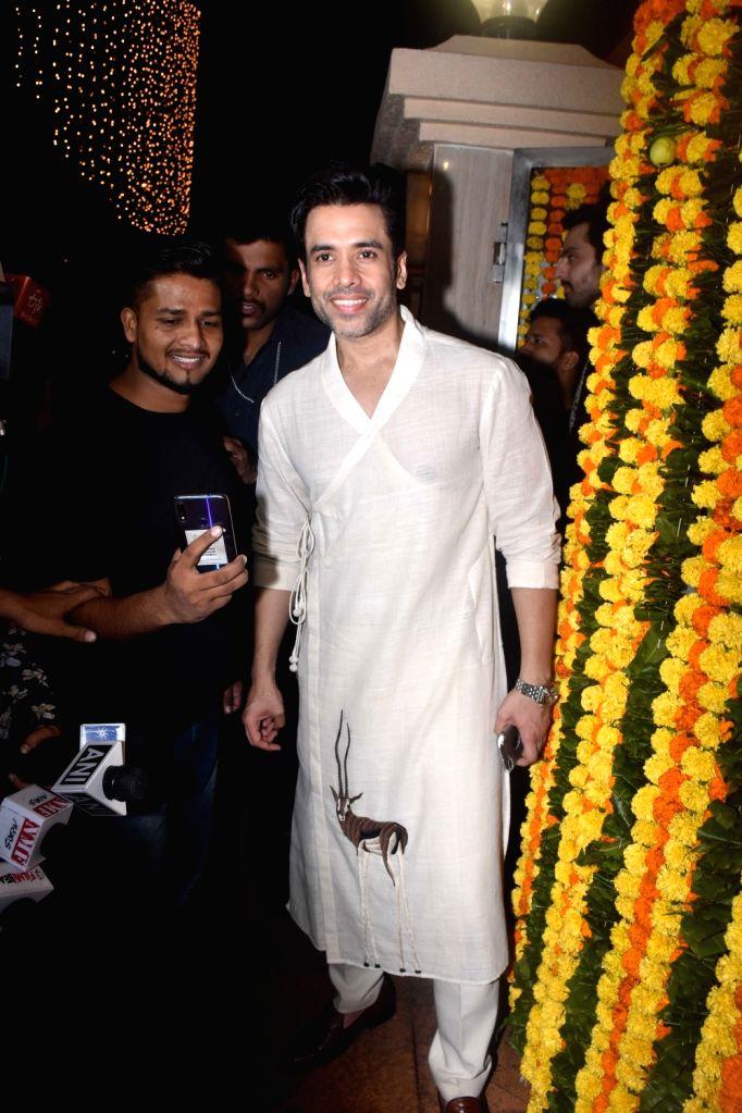 Actor Tusshar Kapoor at the Diwali bash party of producer Ekta Kapoor in Mumbai on Oct 26, 2019. - Tusshar Kapoor and Ekta Kapoor