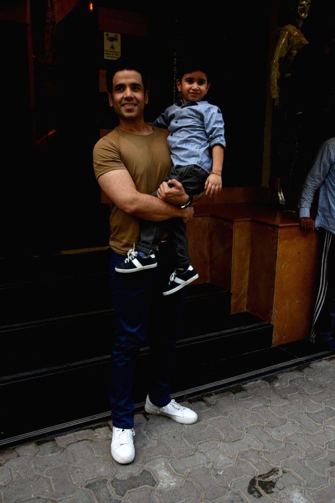 Actor Tusshar Kapoor with his son Laksshya during latter's birthday party in Mumbai on June 1, 2019. - Tusshar Kapoor